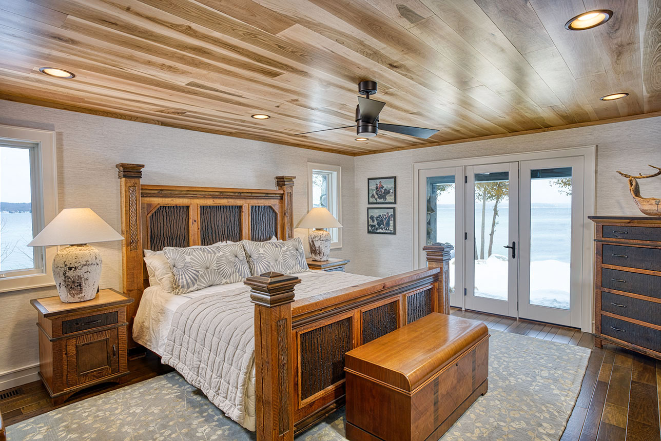 Lakeview bedroom with custom wood ceiling