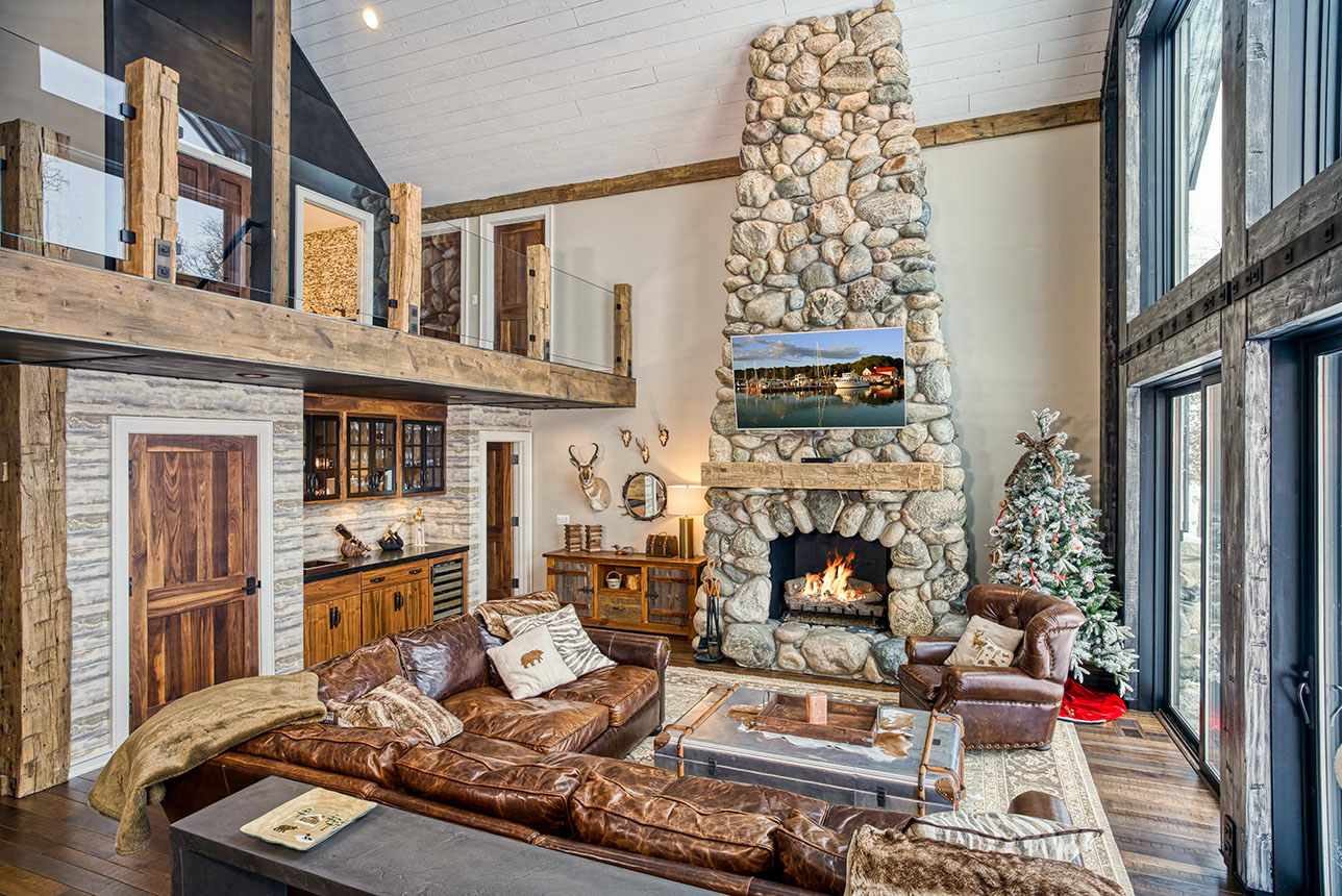 Hand hewn beams, custom cabinets and stone fireplace