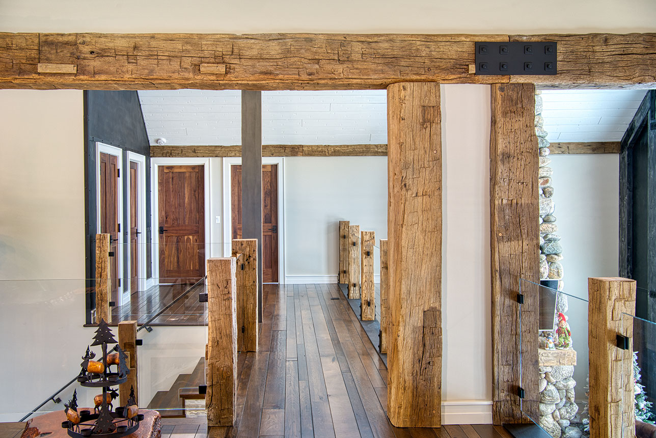 Open hallway with hand hewn beams and posts