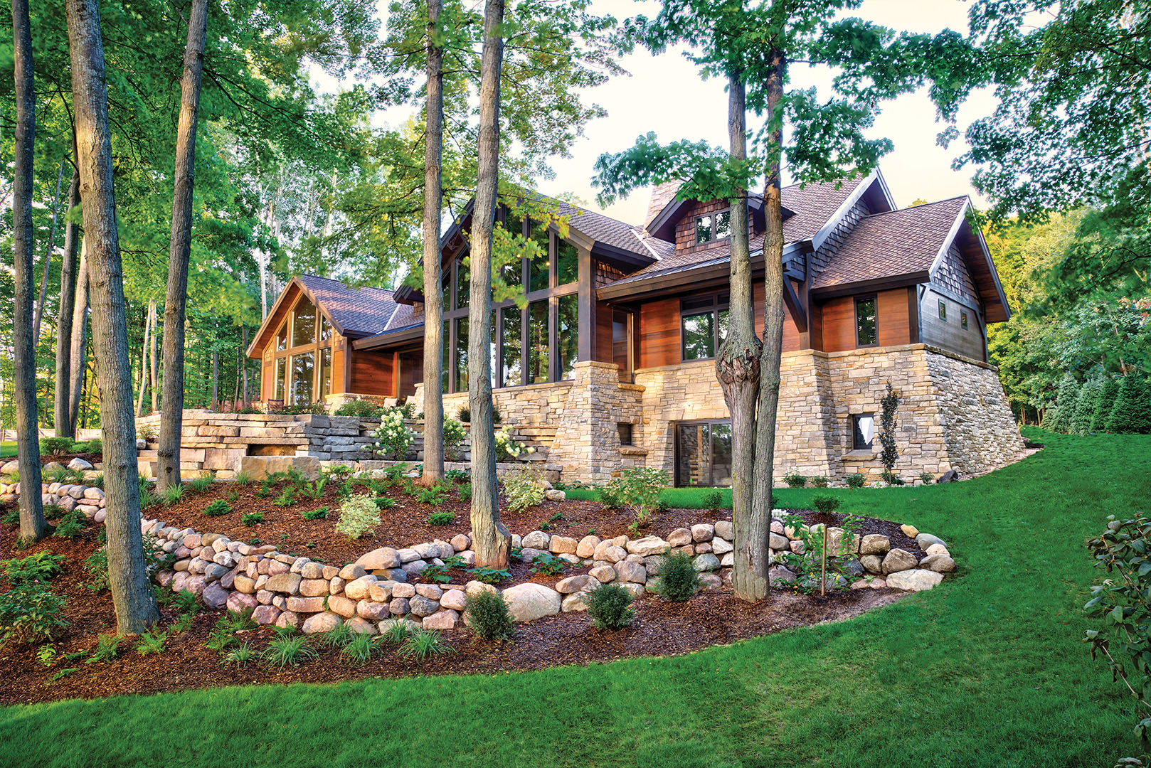 Lakeside custom home and terraced landscaping