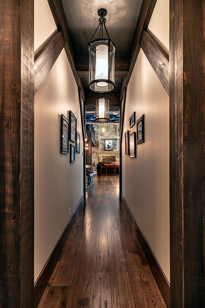 Hallway to the great room with beams and textured ceiling