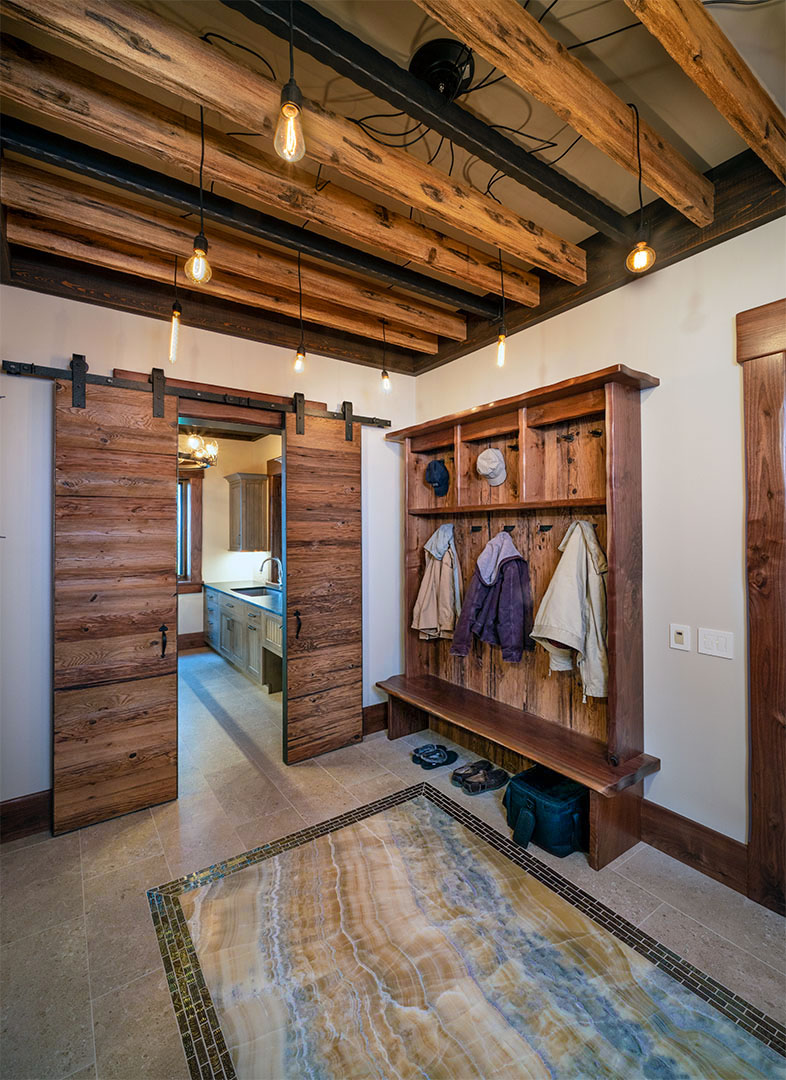 Custom Barn door for laundry complimented by custom ceiling treatment