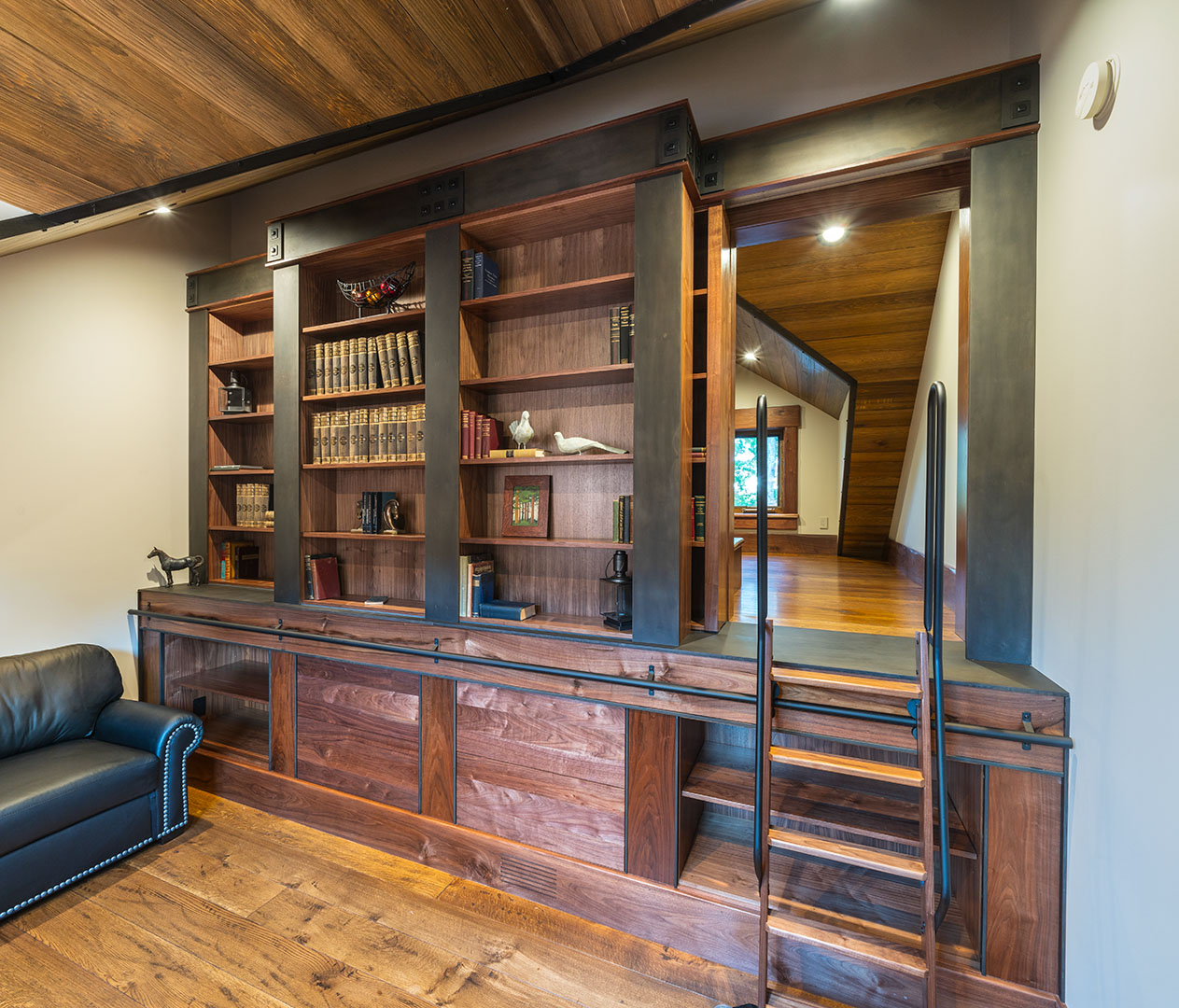Hidden bunkroom accessed with sliding book case