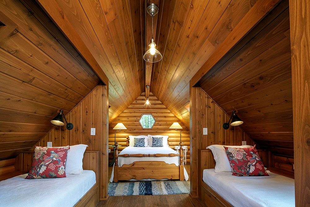 Interior bunkhouse with vaulted wood ceilings