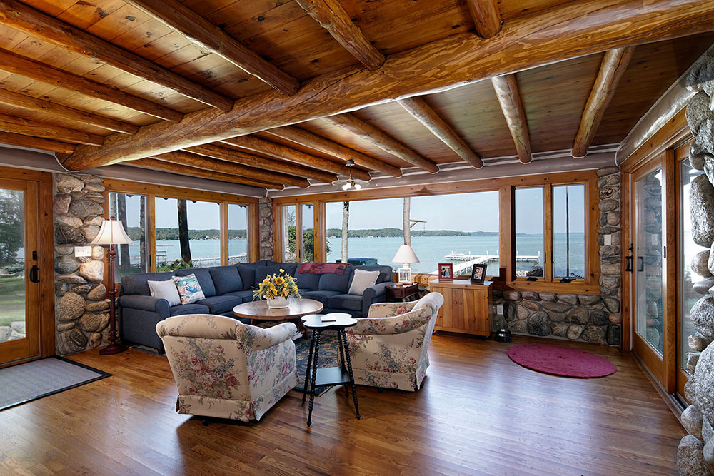 Log cabin addition with lake view